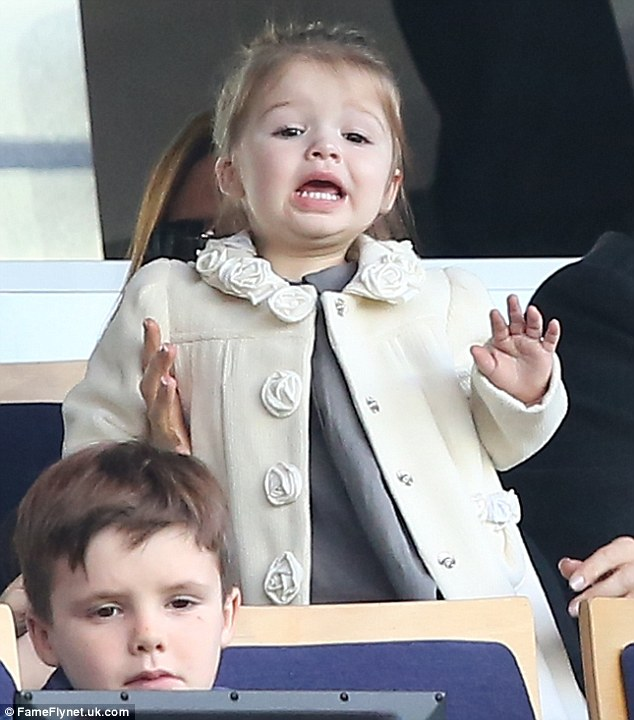 Go Daddy! Despite being just 19-months-old, Harper Beckham is already a football fan, as she proved while cheering on her dad David during his game in Paris on Saturday