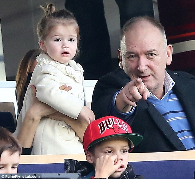 She's a bit young to understand the offside rule! At one point, David's dad Ted was seen explaining something to his granddaughter