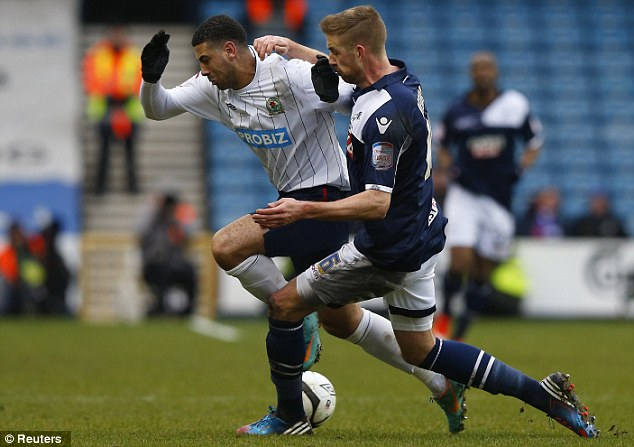 Challenge: Millwall centre back Mark Beevers tackles Leon Best