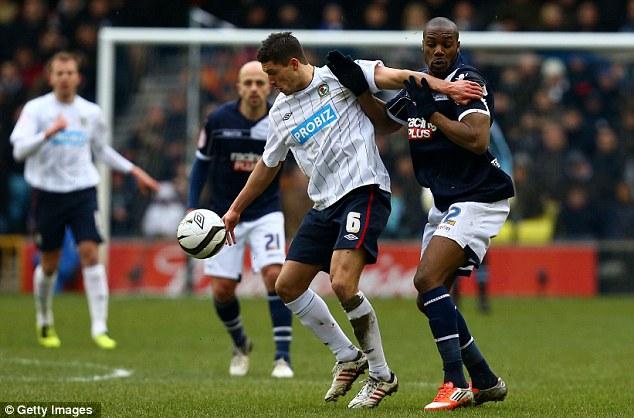 Strength: Jason Lowe of Blackburn Rovers holds off Millwall striker Dany N'Guessan