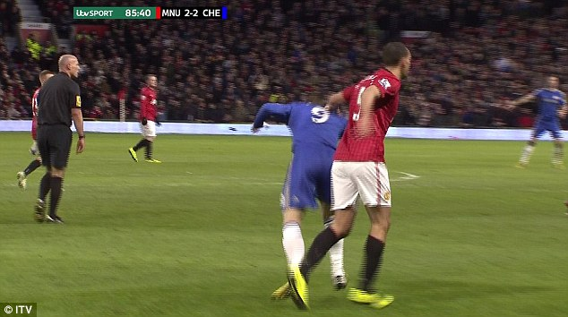 Sneaky: Rio Ferdinand shoved Fernando Torres while the referee's back was turned