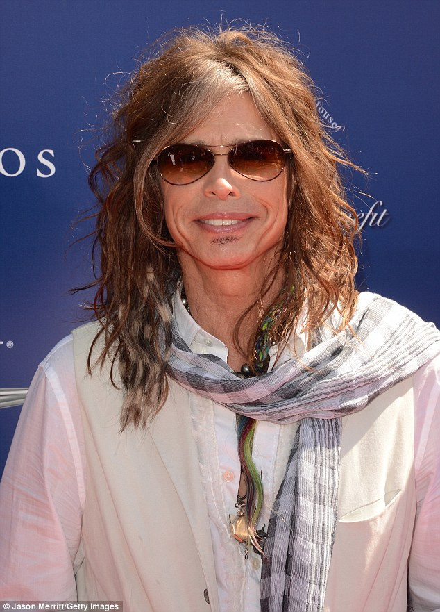 Still got it: The Aerosmith frontman looked younger than his years with his signature wild long hair and brown sunglasses