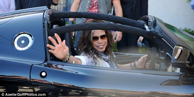I know I look good: The 64-year-old proudly waved to fans as he left the the John Varvatos 10th Annual Stuart House Benefit, where he performed alongside Aerosmith bandmate and lead guitarist Joe Perry