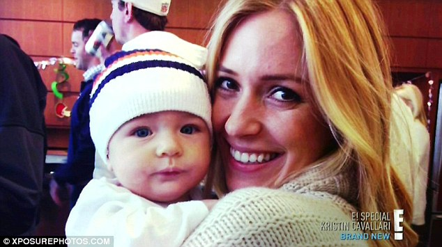 Mommy glow: The blonde beamed as she held her tiny tot close in another photo