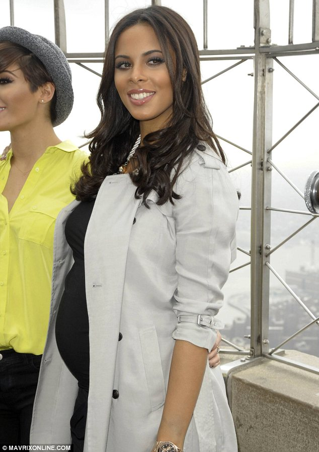 Outfit change: Later in the day Rochelle had worn a pair of loose fitting trousers and a black top with a stone mac for a trip to the Empire State building