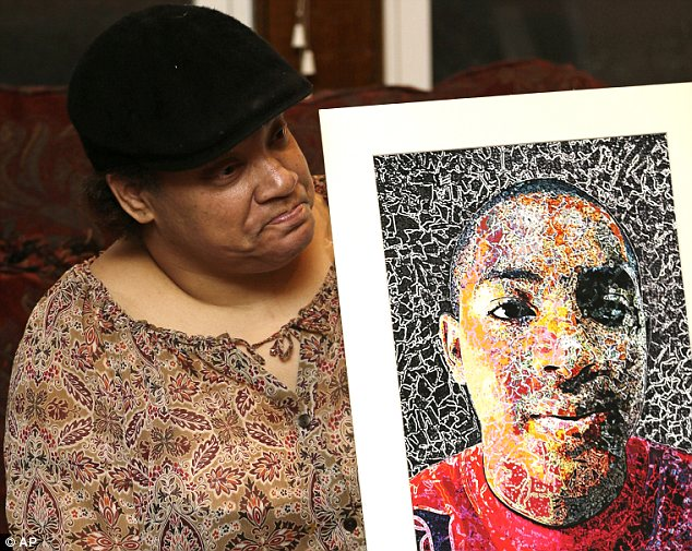 Mourning: Lisa Williamson holds up a self-portrait of her son, Brandon Murray