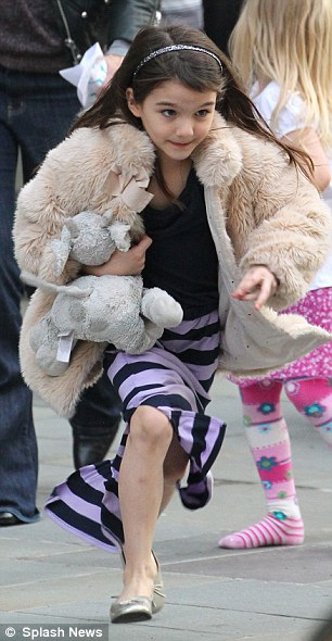 Fashionable: The youngster looked like a fashion star in a faux fur coat and maxi shirt