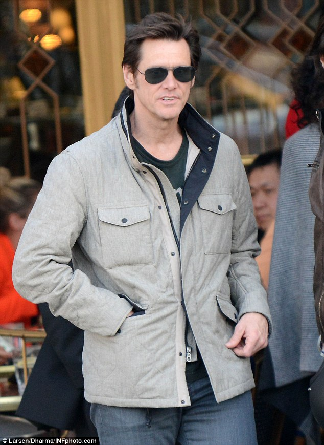 Cool and casual: The actor wore sunglasses and a brown jacket while attending the party
