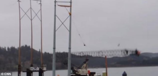 As the crane headed south, it pulled the support tower it was trying to position down with it
