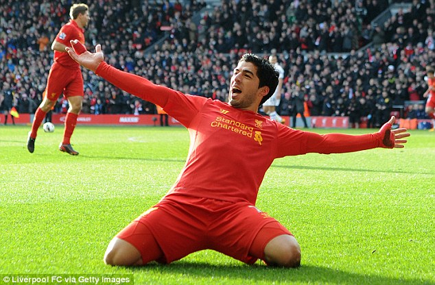 Star of the show: Luis Suarez celebrates his goal for Liverpool against Tottenham on Sunday