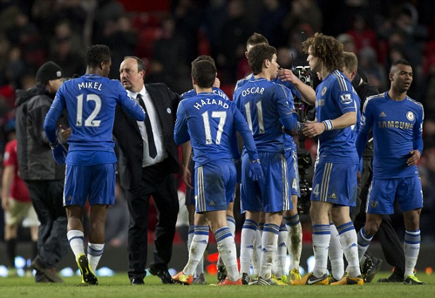 Backing: Mikel and Benitez exchange words after Sunday's draw at Old Trafford
