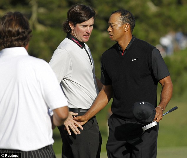 Woods (right) shakes hands with his playing partners Bubba Watson (center) during the second round of the 2012 U.S. Open