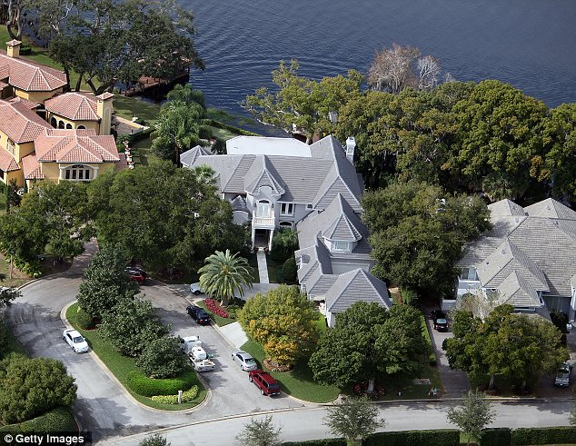 Updated: Watson says he has completed a swath of renovations to the $2.2 million mansion (center) which is located inside the lavish gated community of Isleworth in Windemere