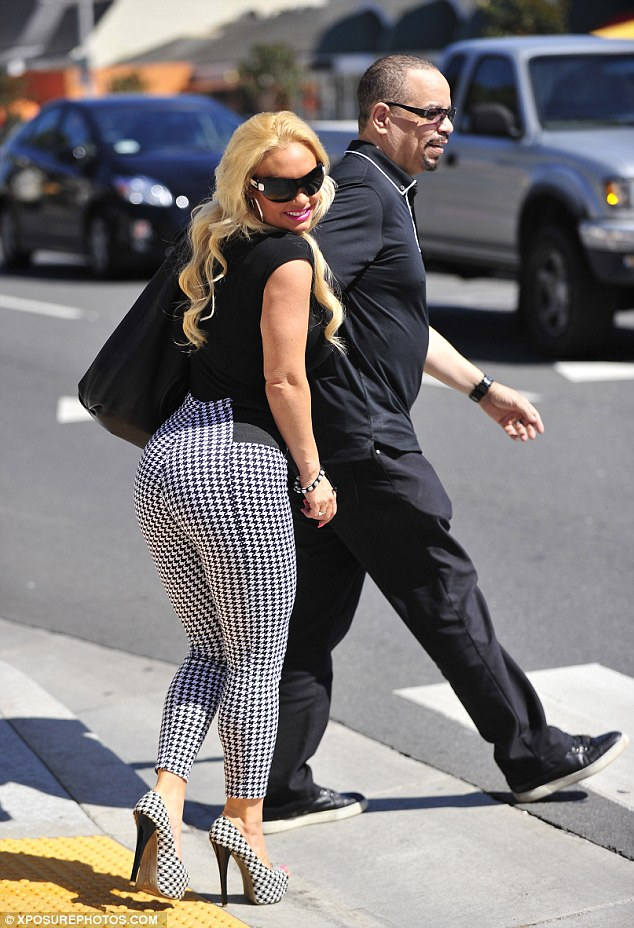 Famous derriere: Coco Austin wore tight houndstooth trousers as she enjoyed a reunion date with husband Ice-T on Monday