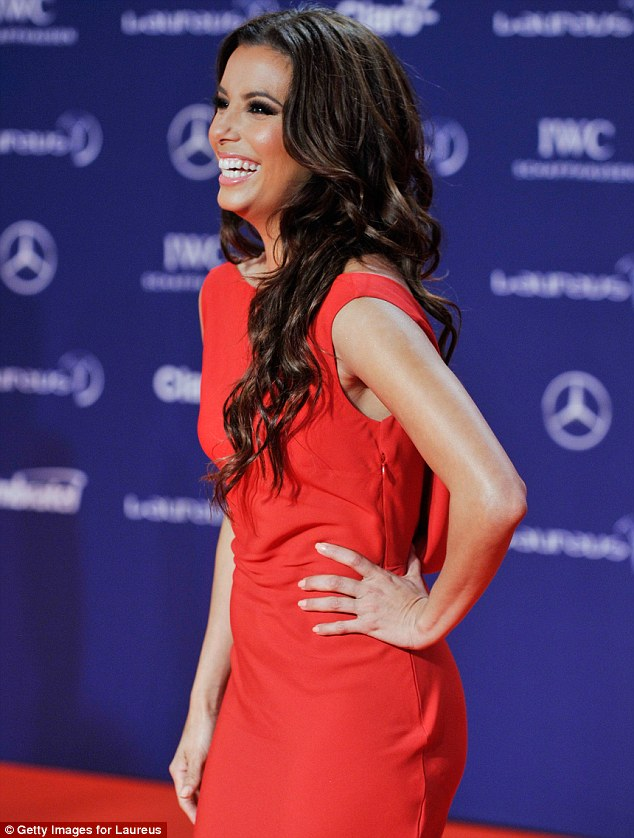 All smiles: Eva giggled as she posed for pictures on the red carpet