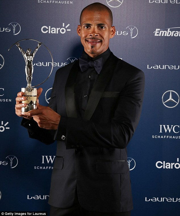 Hold it high! Felix Sanchez poses with the award for Laureus World Comeback of the Year