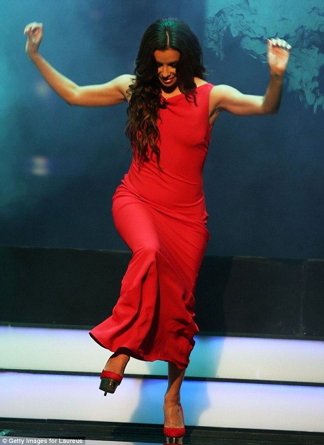 Close call: Eva Longoria nearly tripped on her long red gown as she took to the stage at the 2013 Laureus World Sports Awards in Rio de Janeiro, Brazil on Monday night