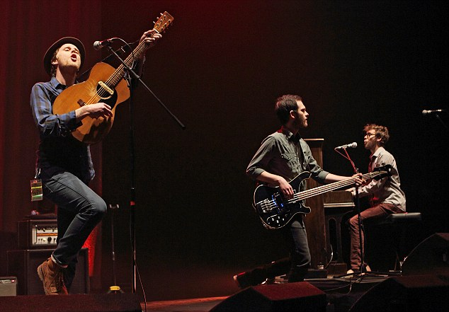 Foot-stomping: Wesley Schultz, Ben Wahamaki and Stelth Ulvang of The Lumineers perform on stage at Brixton Academy