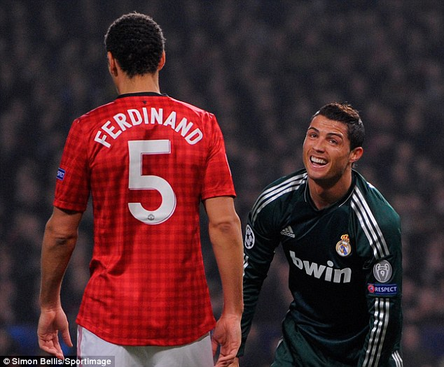 Dejected: Ferdinand his revealed frustration at the loss to Real Madrid and former team-mate Ronaldo (right)