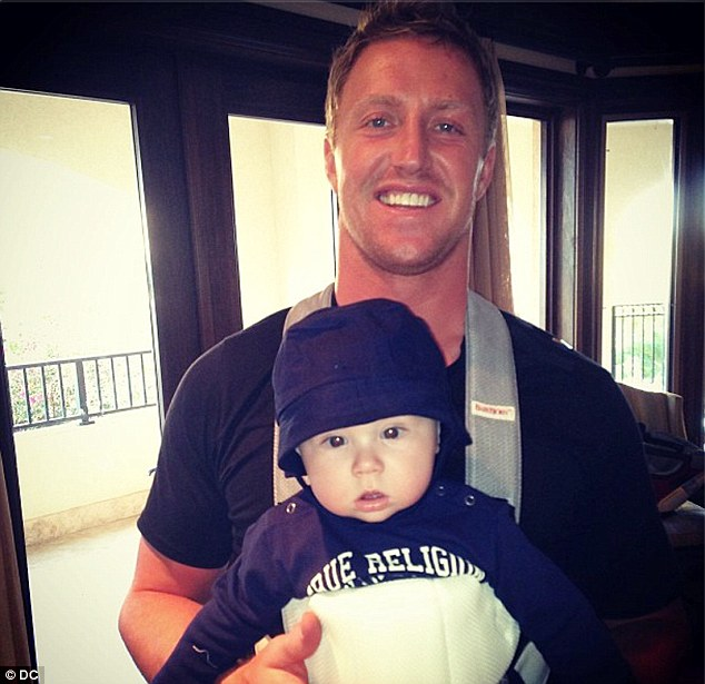 Happy families: Footballer Kroy posed with the couple's youngest son, Kash