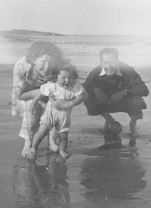 Jenny aged two with her adoptive parents
