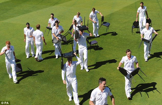 Chairmen of the board: The England players walk off after their team photo shoot (below)
