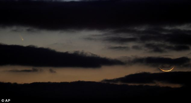 Omen? Pan-STARRS, left, is visible next to a crescent moon in the western sky after sunset over Westminster, Maryland