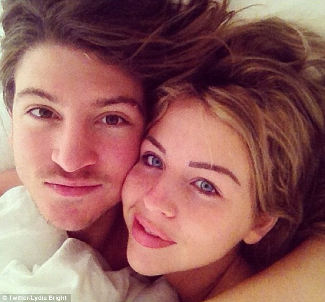 Au naturel? Lydia Bright seemed to be sporting a Scouse brow and plumped-up lips as she cuddled up to boyfriend Tom Kilbey in bed on Wednesday morning