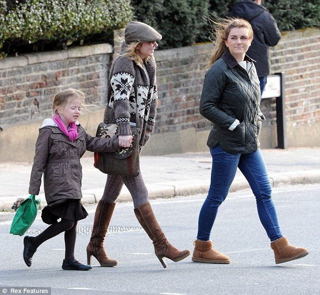 On the go: When Geri's not hopping on the tube she's normally pictured during her school run with her daughter