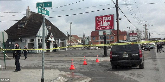 Shooting: Emergency crews work at the scene of a shooting at Gaffey's car wash in the village of Herkimer