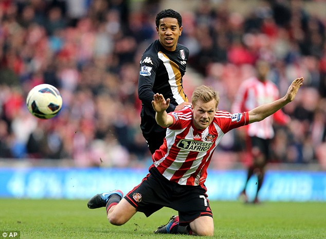 Loan arrangers: Urby Emanuelson (top) at Fulham is one of 33 AC Milan players farmed out to other clubs