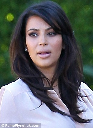 Before: Kim was seen without bangs as she stepped out on Tuesday