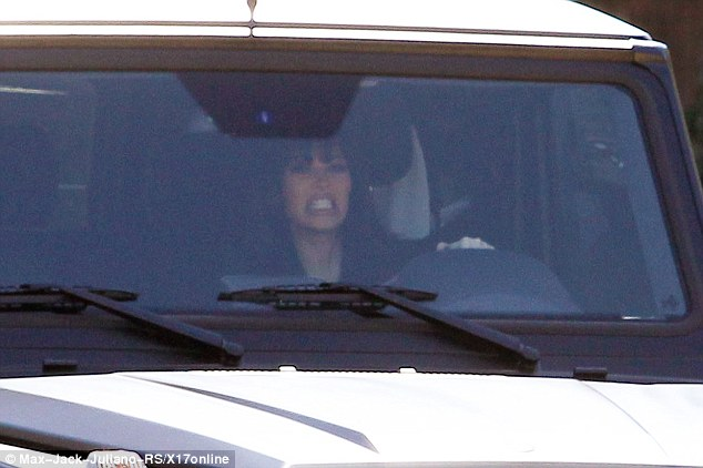 Caught up: Meanwhile, Kim was seen getting caught up in some traffic as she head out in her SUV on Wednesday