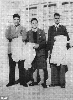 This early 1950s picture released by journalist Sergio Rubin shows Jorge Mario Bergoglio posing with unidentified schoolmates of a preparatory school in Buenos Aires