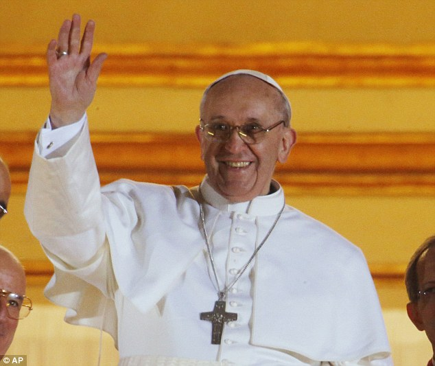 Elected: Pope Francis waves to the crowd from the central balcony of St Peter's Basilica at the Vatican
