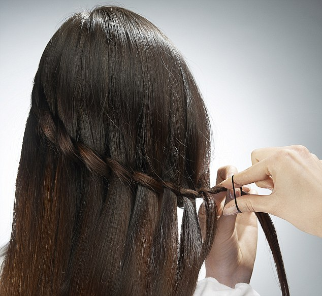 FIVE: Use hairspray to control any flyaway hairs and use shine spray to make your waterfall braid stand out