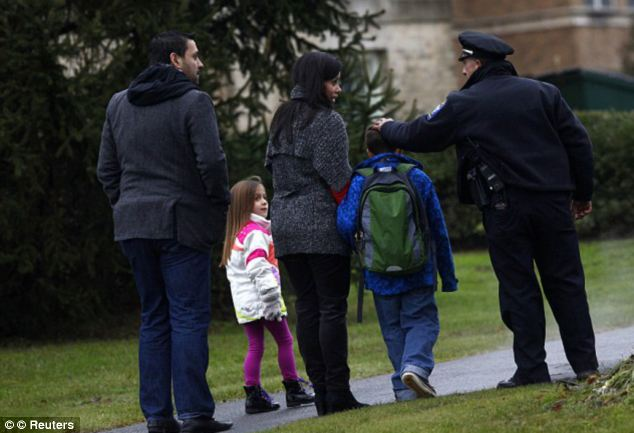 Parents have been volunteering as hall monitors at the Newtown school to help comfort the students still traumatized by the horrific events of Dec 14