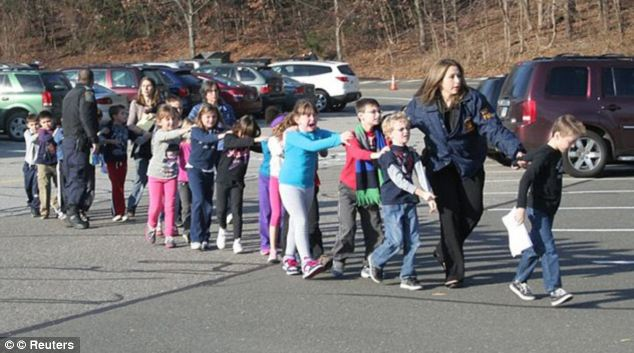 Crying and distressed children being led from Sandy Hook Elementary School after the terrible massacre of December 14