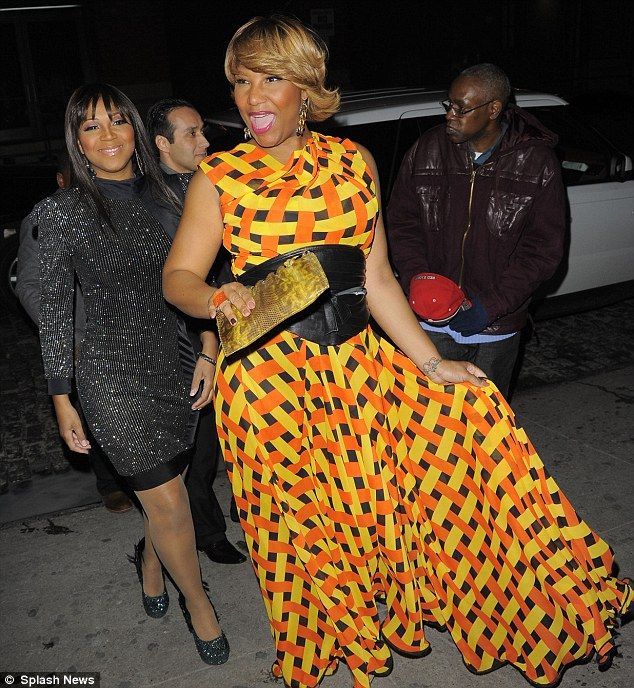 Party time! Trina and Traci Braxton arrive for the bash