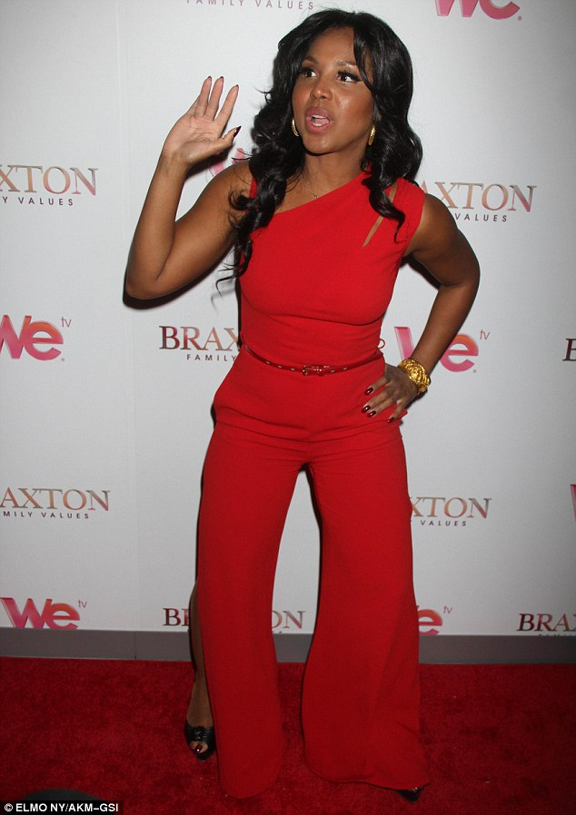 Star of the show: Singer Toni Braxton wore an unusual red jumpsuit