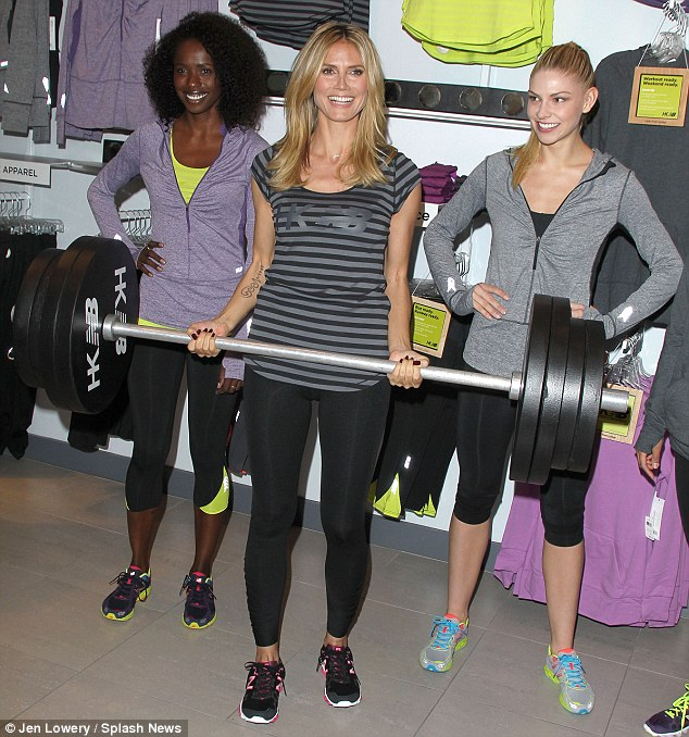 Pumping iron: The German supermodel posed with fellow models at Lady Foot Locker, clad in her workout gear