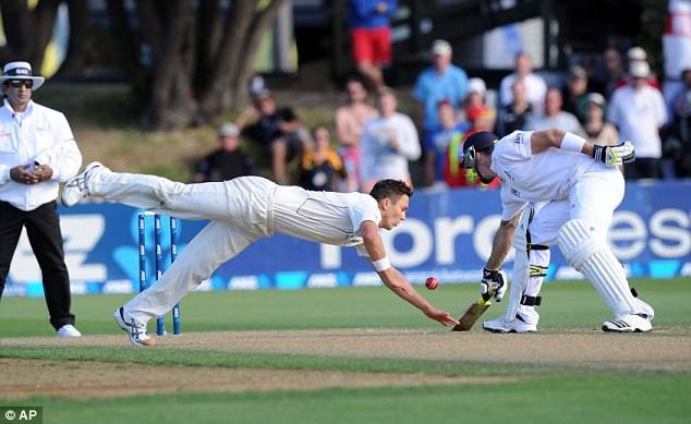 Dive: New Zealand's Trent Boult attempts to field off his own bowling in front of Kevin Pietersen