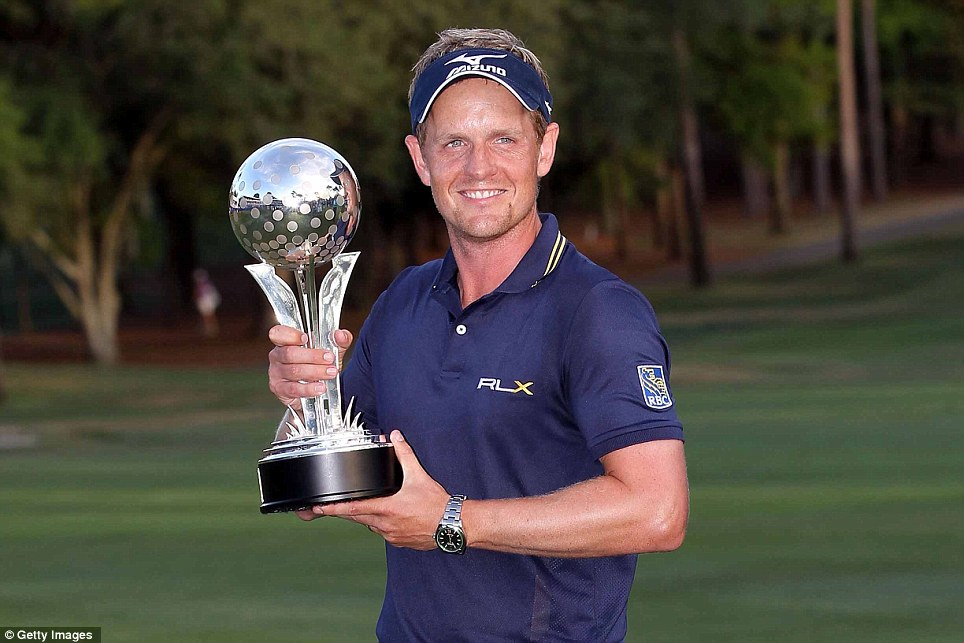 Luke Donald holds the trophy after winning the Transitions Championship at Innisbrook Resort and Golf Club last year. The Englishman recaptured the world No 1 spot from Rory McIlroy with his victory