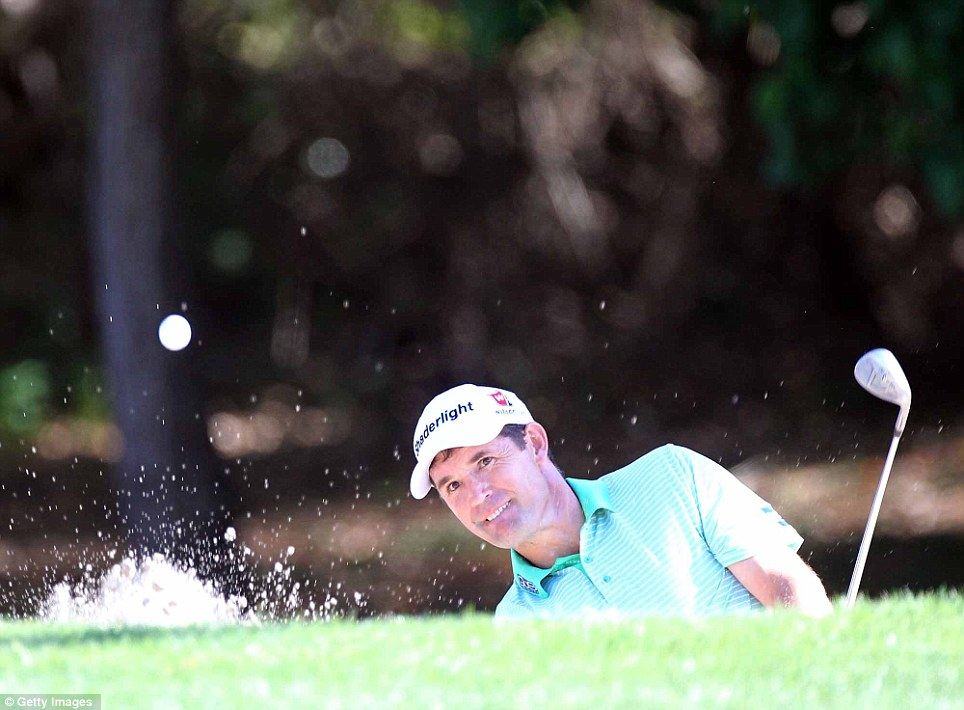 Padraig Harrington splashes out of a bunker on the eighth hole on his way to setting a course record of 61 on the notoriously tough Copperhead track in 2012