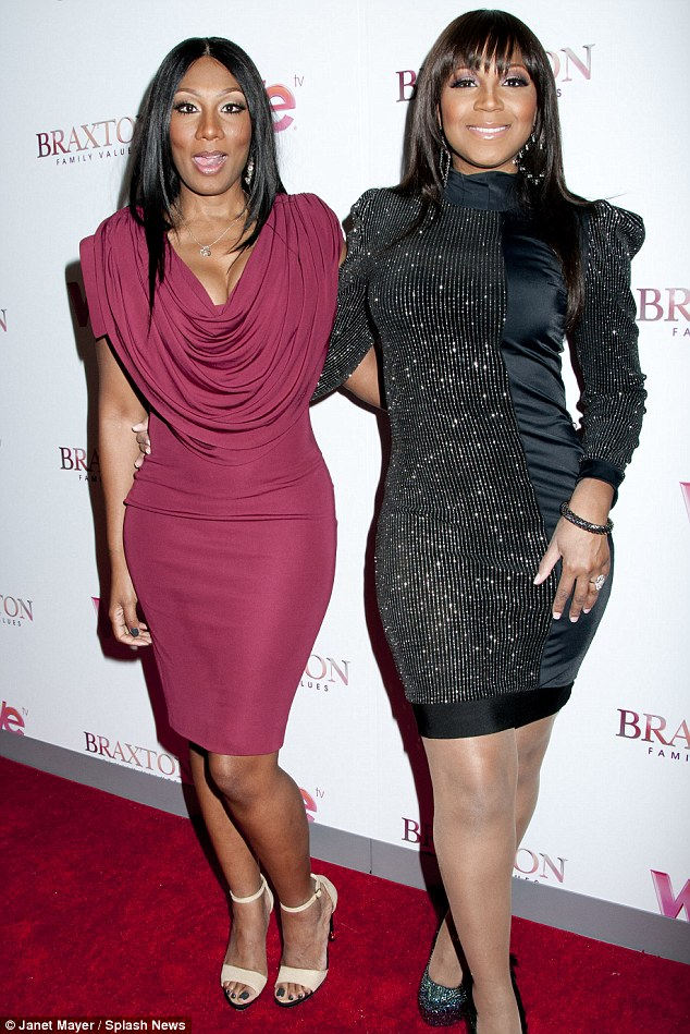 Loving the limelight: Towanda and Trina show off their hourglass figures