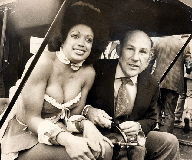 Colourful past: Stirling Moss and Penthouse Pet Susie Lambie in a replica of a 1901 Ford Motor Car