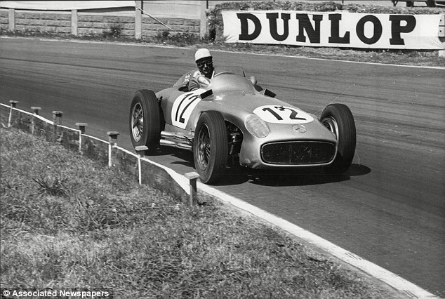 Women and fast cars: Stirling Moss, seen here at the 1955 British Grand Prix, won hundreds of races