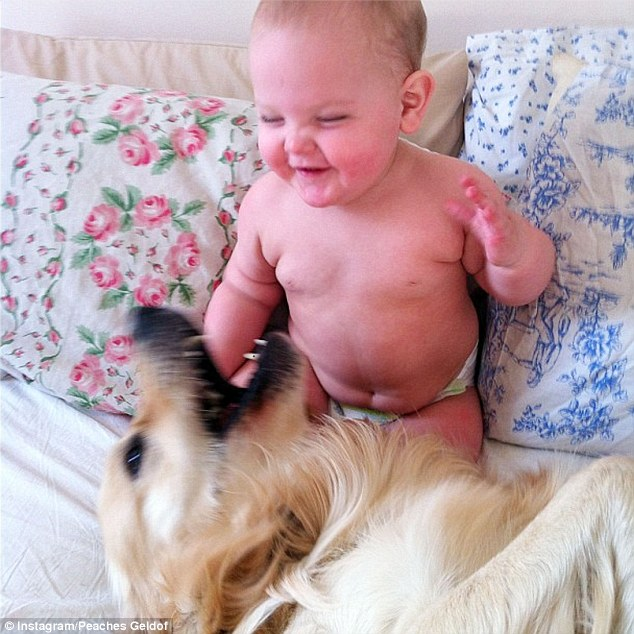 The best of friends: Peaches Geldof's adorable baby son Astala and pet pooch Parpy seemed to be having a whale of a time as they played together on Thursday