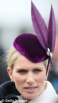 DAY ONE: A vibrant purple velvet piece featuring matching feathers by Jane Taylor