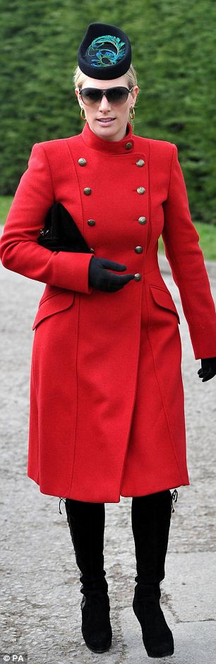 Day two: The royal chose a £300 lambswool coat from the Paul Costelloe label worn with a peacock feather-trimmed pill box hat